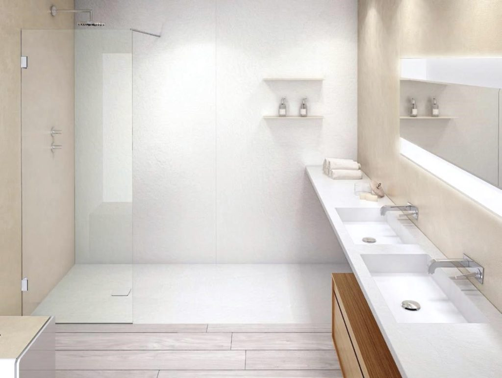 Eine minimalistische Einrichtung fürs Bad mit hellen freien Fläachen und klaren Formen.